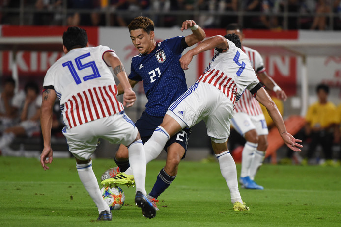 Ritsu Doan (m) in actie tegen Paraguay.