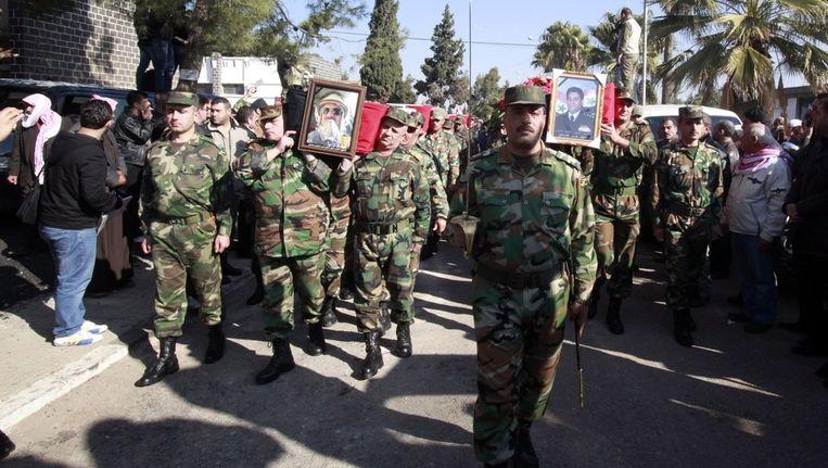 De begrafenis van gedode Syrische militairen, eerder deze week. Beeld epa