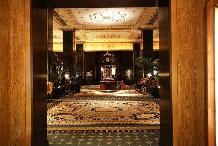 De lobby van het fameuze Waldorf-Astoria hotel in New York. Beeld AFP