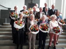 Dertien Enschedeërs koninklijk onderscheiden in stadhuis