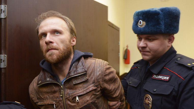 De Russische fotograaf Denis Sinjakov, een van de 30 mensen die aan boord waren van de Arctic Sunrise. Beeld getty