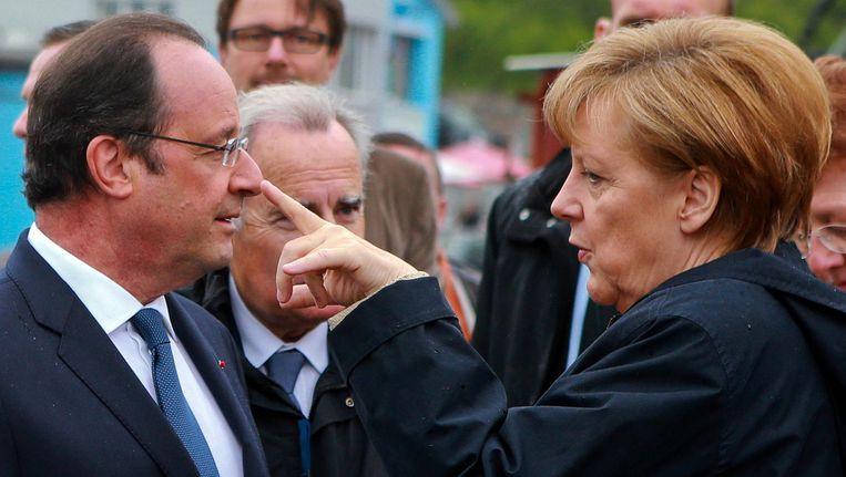 De Duitse bondskanselier Angela Merkel met de Franse president François Hollande. Beeld ap