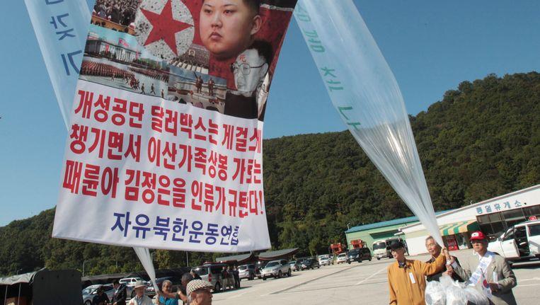 Noord-Koreaanse vluchtelingen bij een demonstratie tegen het Noord-Koreaanse regime in Paju, Zuid-Korea. Beeld ap