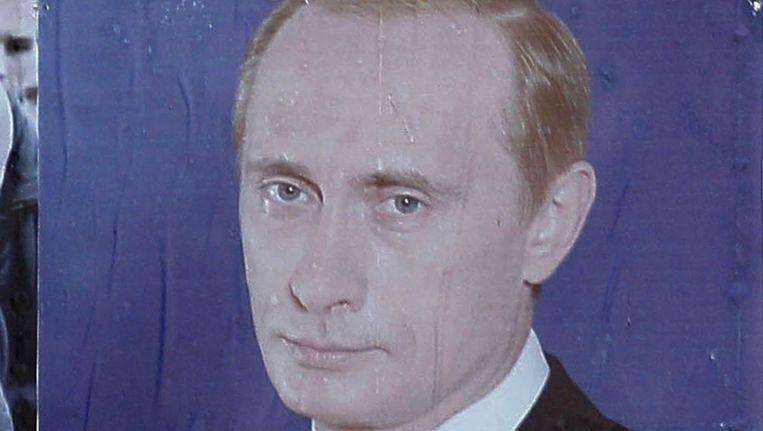 Campagnefoto van premier Poetin aan een balkon in het centrum van Moskou. Beeld null