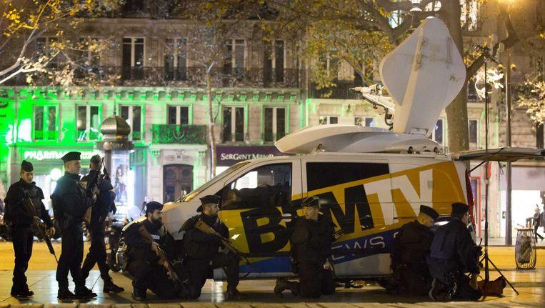 Franse politie op het Place de la Republique nadat er paniek uitbrak. Beeld anp