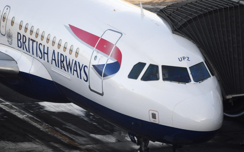 Een toestel van British Airways op de Londense luchthaven Heathrow, waar zondag duizenden passagiers hun vluchten zagen geannuleerd.