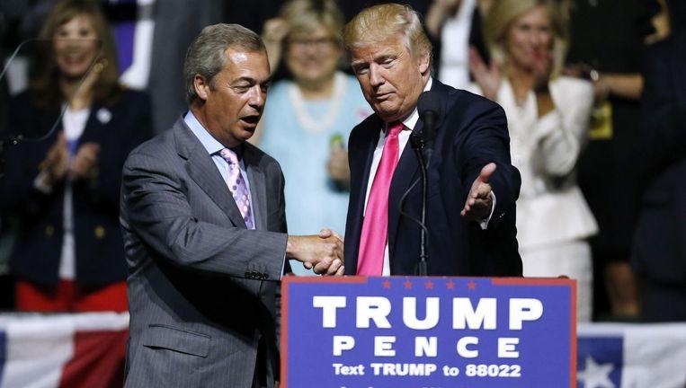 Nigel Farage en Donald Trump tijdens een bijeenkomst in augustus 2016 Beeld afp