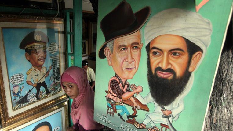 Een schilderij van George W. Bush en Osama bin Laden in Jakarta. Beeld epa