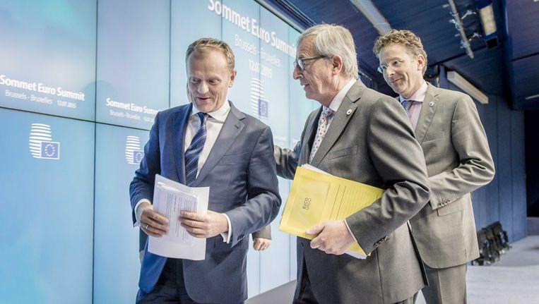Tusk, Juncker en Dijsselbloem na afloop van de marathonvergadering in Brussel, waaruit een Grieks akkoord is gekomen. Beeld anp