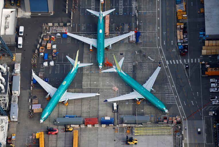 Boeing 737 MAX-toestellen staan geparkeerd bij de Boeing-fabriek in Rengton, Washington. De 737 MAX mag al maanden de lucht niet meer in. Beeld REUTERS