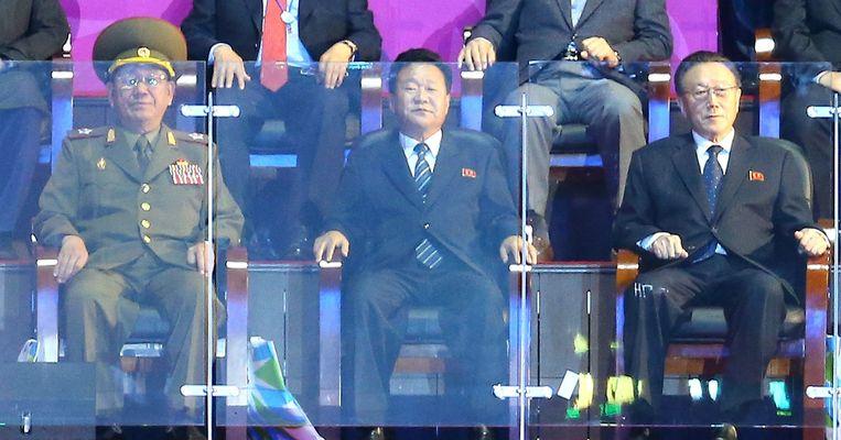 Hwang Pyong-so, Choe Ryong-hae en Kim Yang-gon tijdens de Asian Games in Seoul. Beeld epa