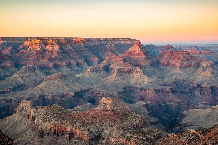 Foto ter illustratie van de Grand Canyon.