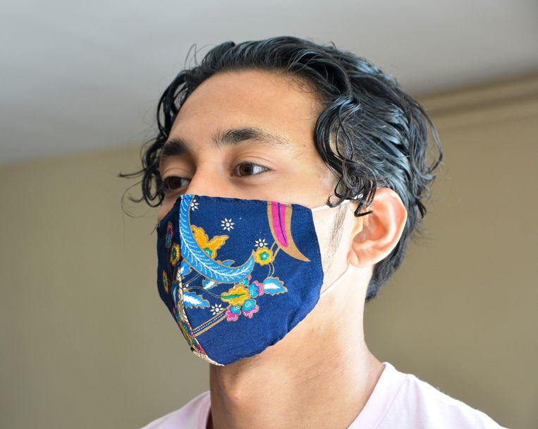 Een mondkapje van batik. Beeld The Batik Mask