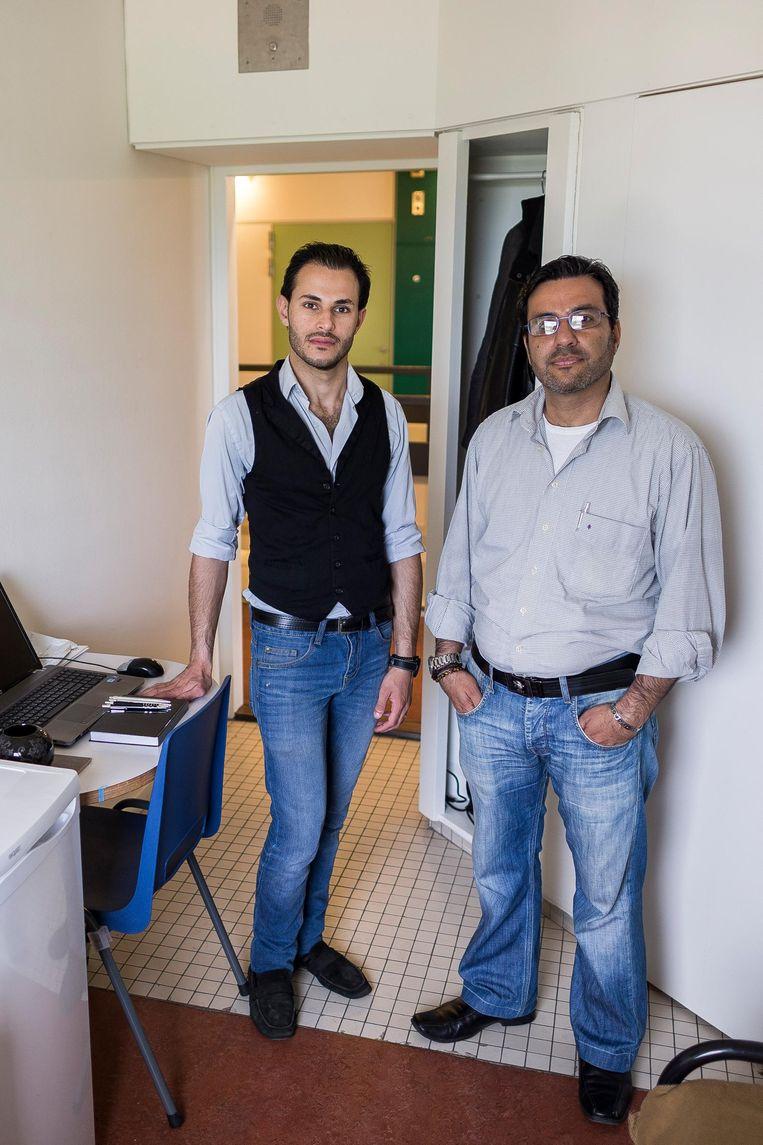 Basem (45) en Anas (23), vader en zoon uit de Syrische hoofdstad Damascus Beeld Rink Hof