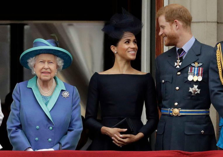 Koningin Elizabeth en Harry en Meghan.