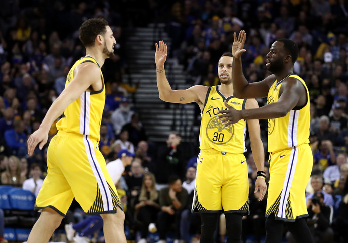 Stephen Curry, Draymond Green en Klay Thompsen van Golden State Warriors.
