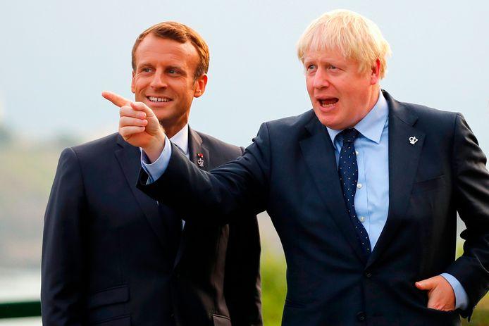 De Britse premier Boris Johnson met de Franse president Emmanuel Macron tijdens de G7-top in het Franse Biarritz.