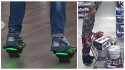 Winkeldief op gemotoriseerde rollende schoenen vlucht met volle kar