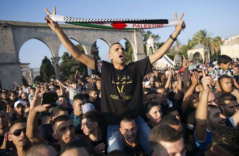 Een Palestijnse demonstratie in Jeruzalem tegen het Israëlische offensief op de Gazastrook. Beeld afp