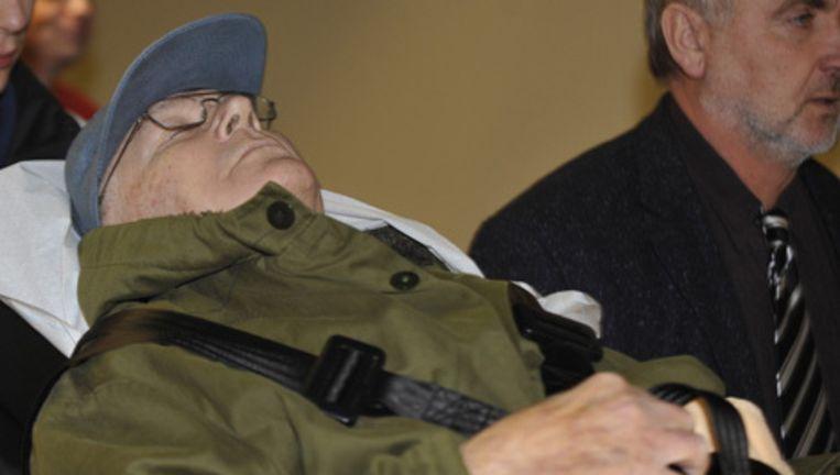 John Demjanjuk op de ochtenzitting; 's middags lag hij op een bed. Foto AP Beeld
