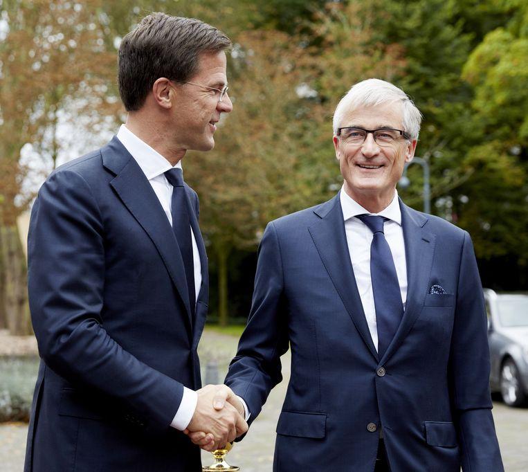 Mark Rutte en Geert Bourgeouis tijdens een kennismakingsbezoek in 2014. Beeld ANP