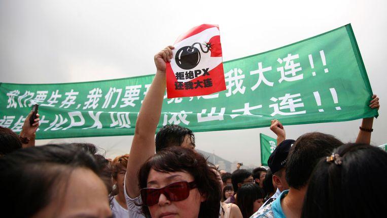 Inwoners van Dalian protesteerden massaal tegen de fabriek. Beeld REUTERS