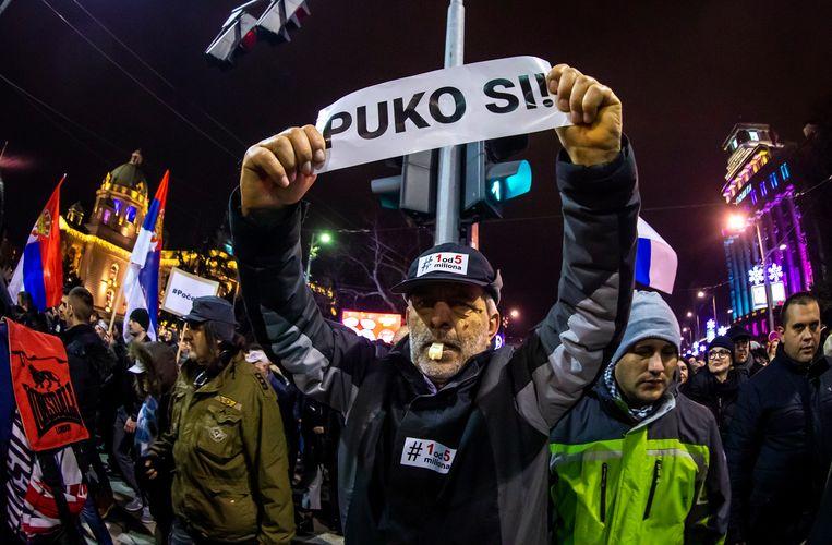 """De betogers droegen spandoeken met daarop slogans tegen de regering: """"Ik zal niet zwijgen"""", """"Ik ben niet dom""""."""