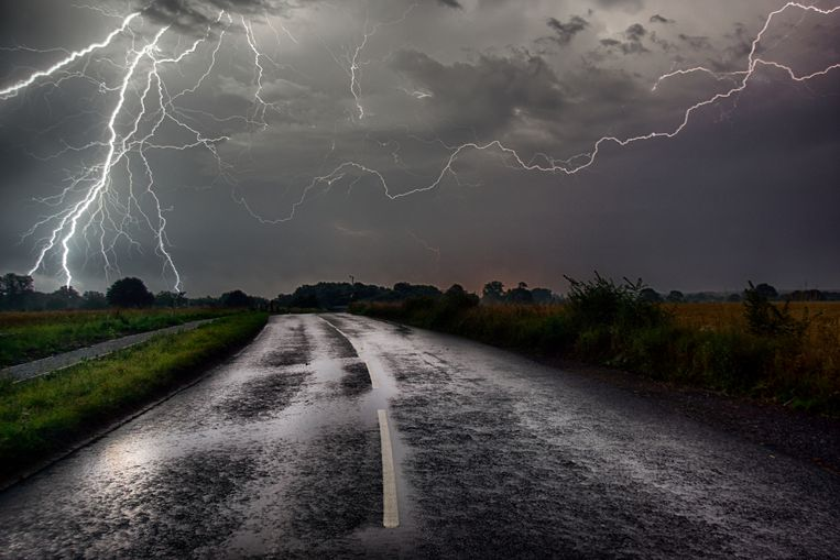 Bolts of Lightning caught at the end of the road. onweer