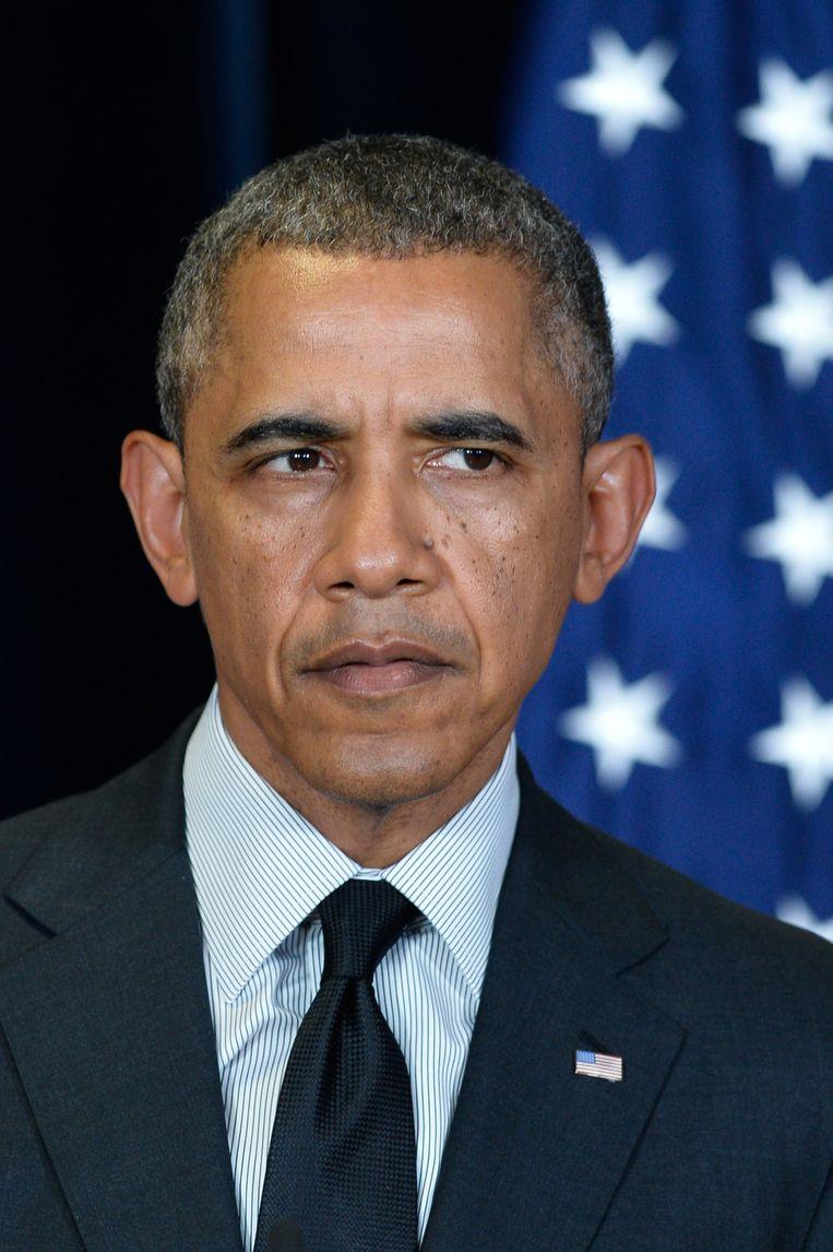 De Amerikaanse president Obama zou geen officiële ontmoeting willen hebben met Poetin, uit onvrede over diens gestook in Oost-Oekraïne. De VS en de EU dreigen met extra sancties tegen Rusland. Beeld belga