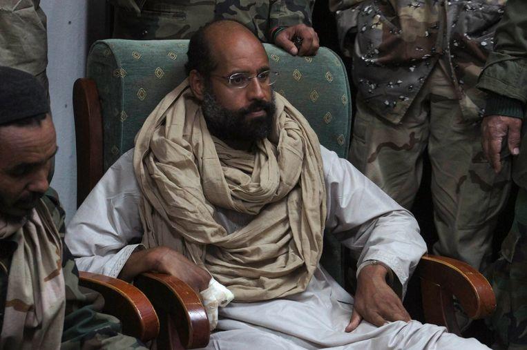 Saif al-Islam nadat hij werd gearresteerd, afgelopen zaterdag. Beeld REUTERS