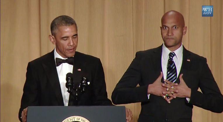 Obama met zijn woede-vertaler Luther. Beeld YouTube