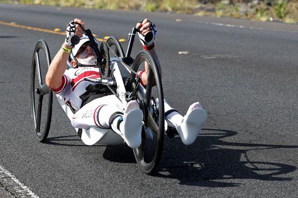 Paratriathlete Kim Plovier, of Belgium, races in the Ironman World Championship Triathlon, Saturday, Oct. 12, 2019, in Kailua-Kona, Hawaii. (AP Photo/Marco Garcia)