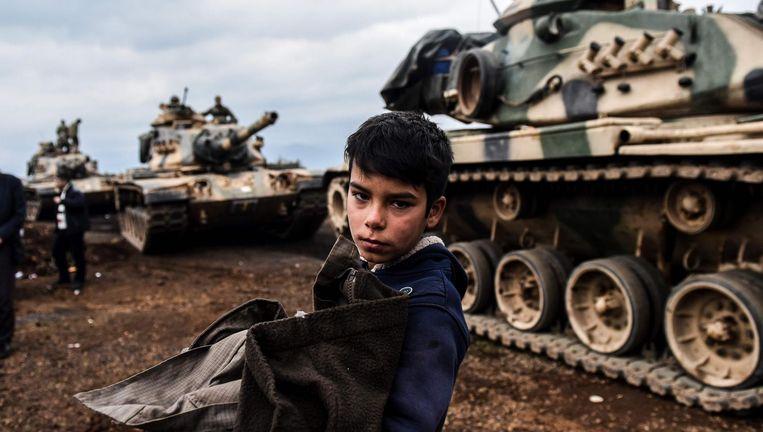 Turkse tanks rijden Syrië binnen om er Koerdische milities te bestrijden. Volgens sommige theorieën zou de droogte in het land aan de basis liggen van het gewapend conflict. Beeld afp