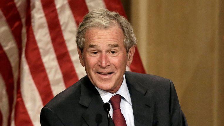 Bush tijdens een bijeenkomst in Dallas, Texas Beeld ap