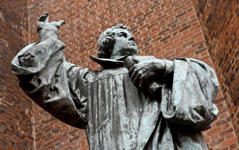 Een standbeeld van Luther in Hannover. Beeld AFP