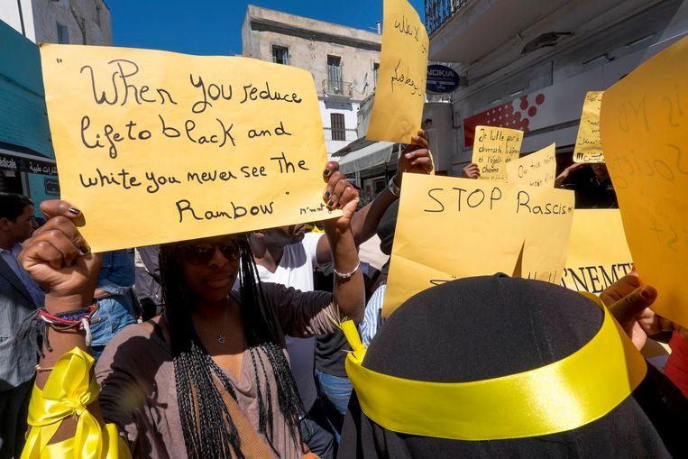 Een demonstratie tegen racisme in Tunis, 1 mei 2014. Beeld Corbis via Getty Images
