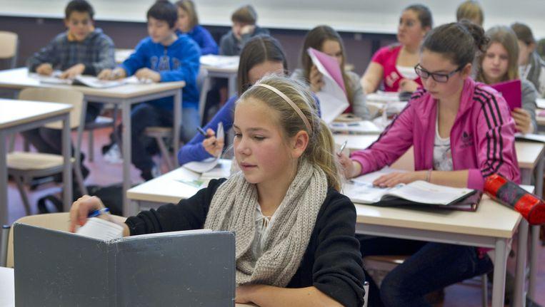 Meisjes zijn steeds beter in exacte vakken, mede door de feminisering van het onderwijs. Beeld anp