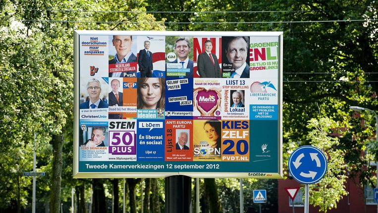 Bord met verkiezingsposters in Den Haag. Beeld Nederlandse Freelancers