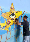 Steven Hopman aan het werk bij de Graffiti Jam van 2016.