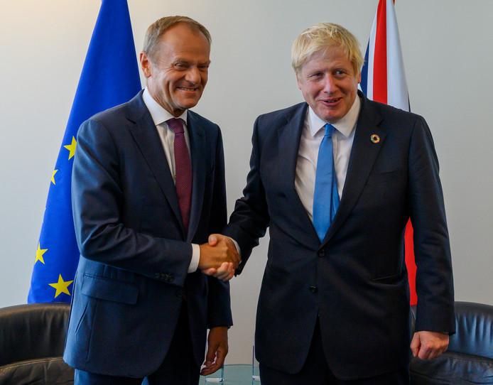Voorzitter van de Europese Raad Donald Tusk (links) en de Britse premier Boris Johnson tijdens hun ontmoeting in het VN-gebouw maandag.