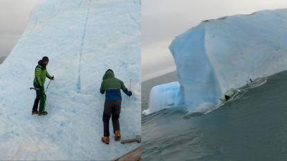 Gigantische ijsberg kantelt en valt op mannen die rots beklimmen