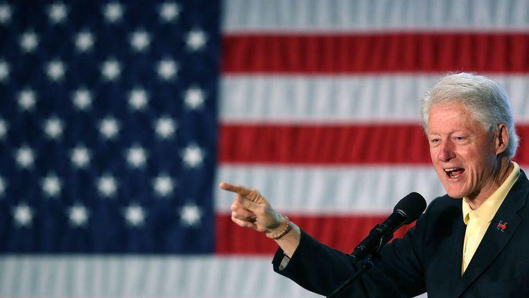 Bill Clinton op campagne voor zijn vrouw Hillary. Beeld null
