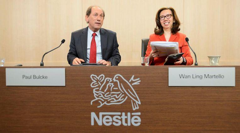 Nestlé-bestuurders Paul Bulcke en Wan Ling Martello. Beeld epa