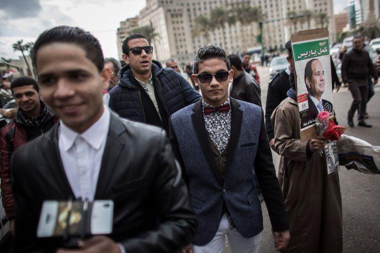 Aanhangers van de Egyptische president Abdel Fattah al-Sisi in 2016 op het Tahirplein in Caïro. Beeld EPA