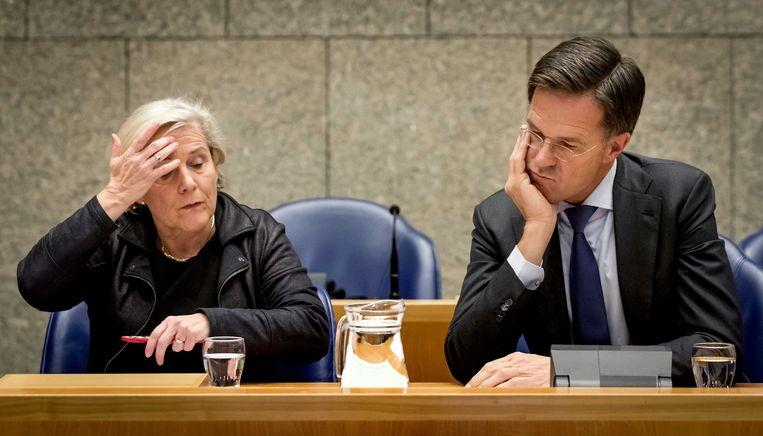 Ank Bijleveld, minister van Defensie en premier Mark Rutte tijdens het debat in de Tweede Kamer. Beeld ANP