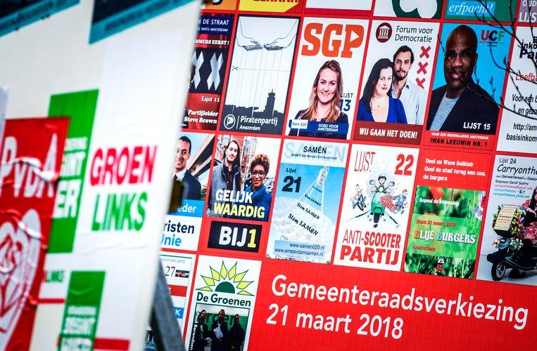 Posters voor de gemeenteraadsverkiezingen in Amsterdam. Beeld ANP