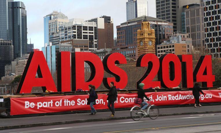 Een bord bij de plek waar de aidsconferentie in Melbourne wordt gehouden. Beeld epa