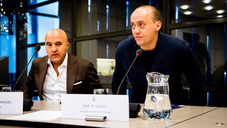 Misdaadjournalist John van den Heuvel van De Telegraaf en Paul Vugts, misdaadjournalist Het Parool, tijdens een rondetafelgesprek in de Tweede Kamer over de bedreiging en bescherming van journalisten. Beeld ANP