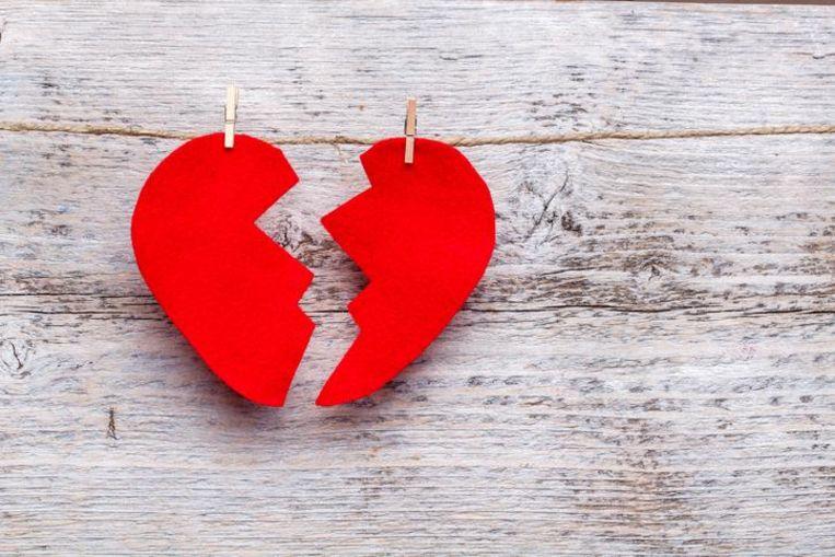 Broken heart hanging on rope