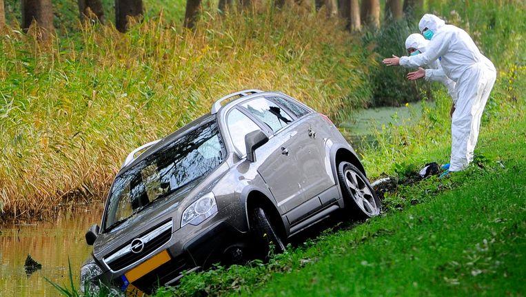 Forensisch onderzoek bij de auto van Peter 'Pjotr' R., op wie in november 2015 een mislukte aanslag werd gepleegd. Beeld anp